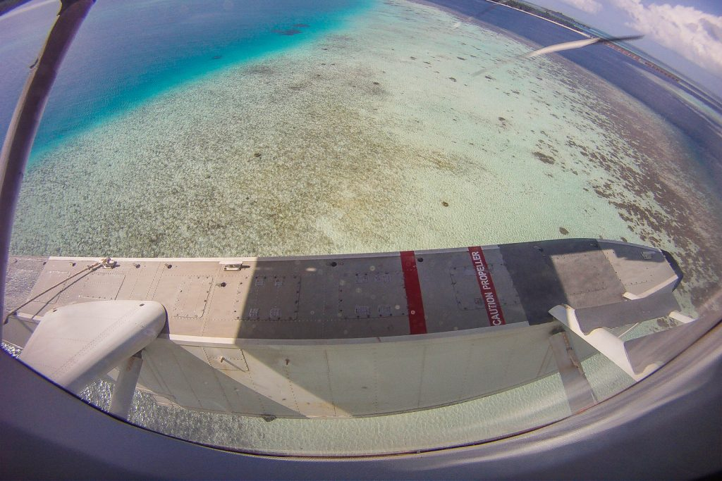Flying over LUX Dhidhoofinolhu Maldives resorts by maldavian air taxi floatplane service male airport