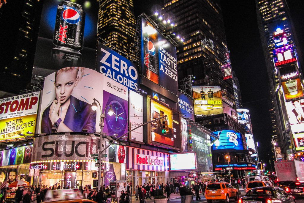 Time Square Night things to do in nyc and on the new york itinerary. Flight seeing Statue of Liberty, Manhattan helicopter tours, hudson, chelsea, empire state building, central park, brooklyn bridge. One of many things to do in new york.
