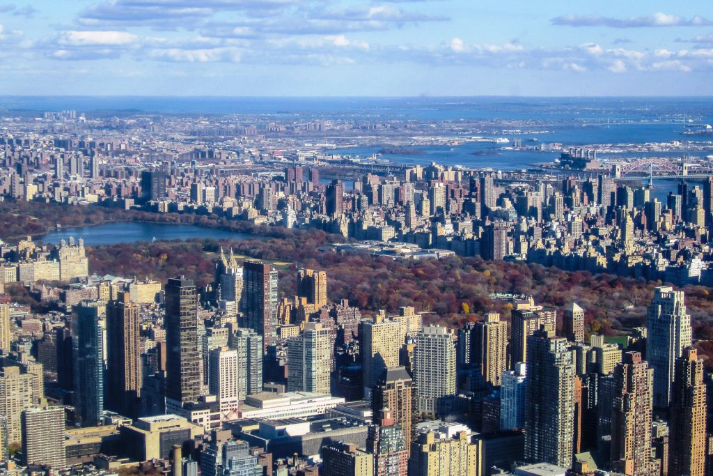 First view of Central Park NYC helicopter tours give views acros the New York City skyline. One of the best things to do in NYC and on the new york itinerary. Flight seeing Statue of Liberty, Manhattan helicopter tours, hudson, chelsea, empire state building, central park, brooklyn bridge. One of many things to do in new york.