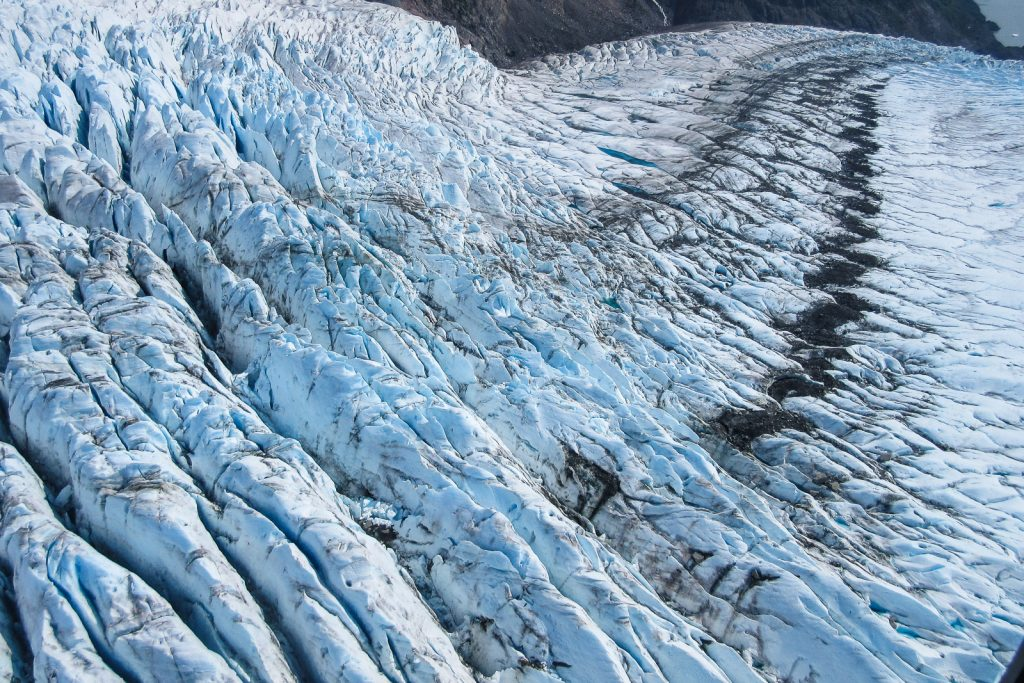 Flying down the Mendenhall Glacier from Juneau Icefield in Alaska