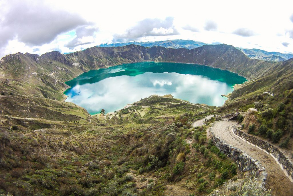 A path descends to the bottom of Laguna Quilotoa in Ecuador. Its a steep walk in places and best to get a horse ride back up from lake quilotoa because of the high altitiude, it is a strenuous climb back to the top.