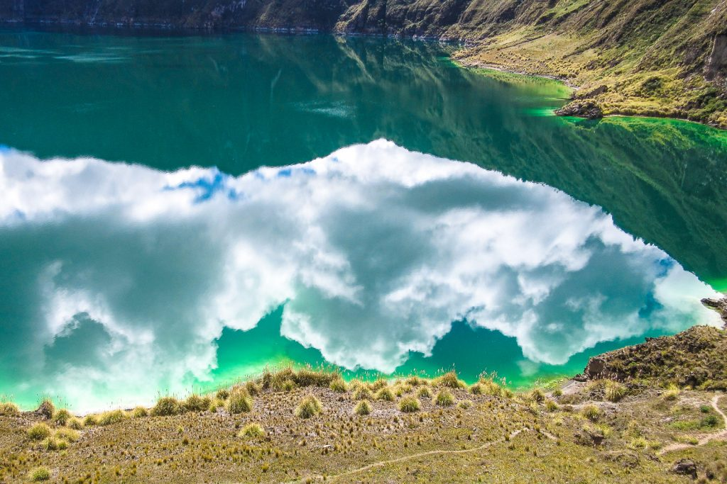 Quilotoa Loop in Ecuador is a ttunningly beautiful road which loops through the Ecuador countryside. Laguna Quilotoa, is the highlight with crystal clear turquoise waters.