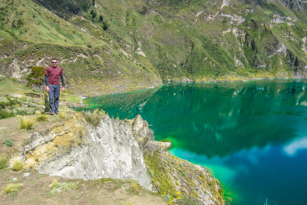 Standing in the Quilotoa Crater next to Laguna Quilotoa ( Quilotoa Crater Lake) in Ecuador, top things to do in South America