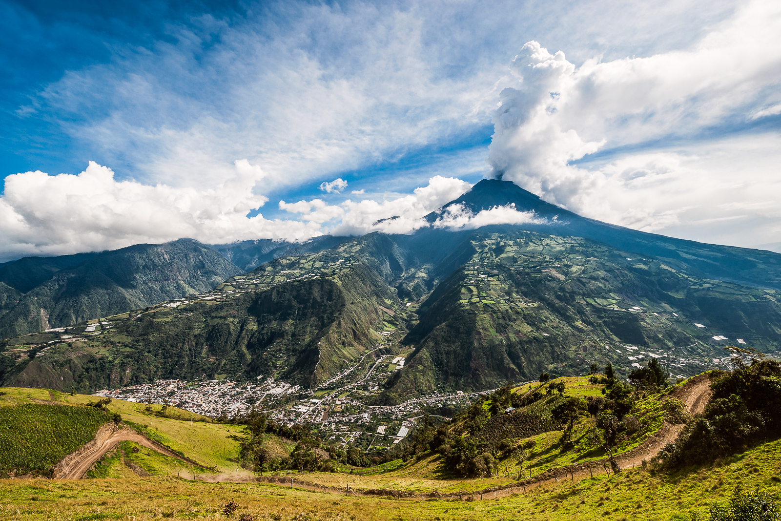 Things to do in Ecuador is visiting the town of Banos. With a nearby active volcano often erupting. Pictured is the Eruption of a volcano Tungurahua, Cordillera Occidental of the Andes of central Ecuador, South America