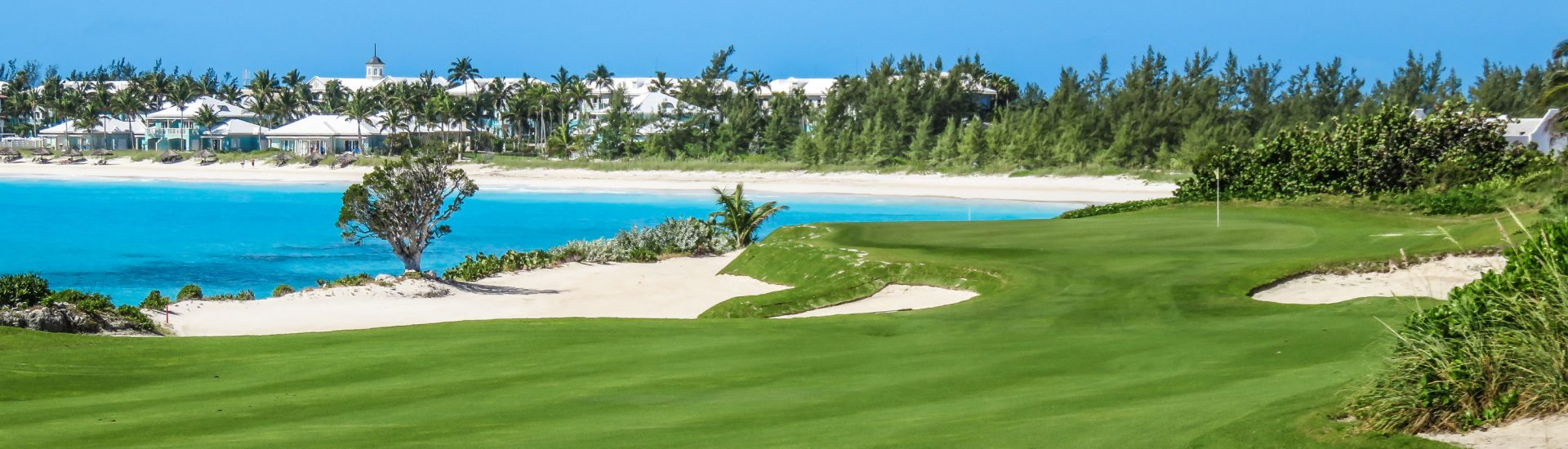 Emerald Bay Bahamas is home to the Grand Isle Resort and Spa, Sandals Emerald Bay and a championship golf course. Beautiful beach at Emerald Bay on Exuma Island in the Bahamas out islands.