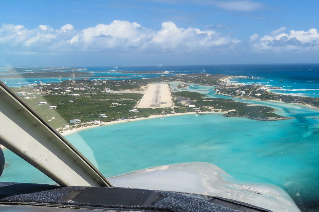 Flying into Staniel Cay Airport in the Exuma Cays. From Staniel Cay you can visit the Exuma Pigs, swimming pigs, iguanas, Thunderball Grotto from James Bond film Thunderball.