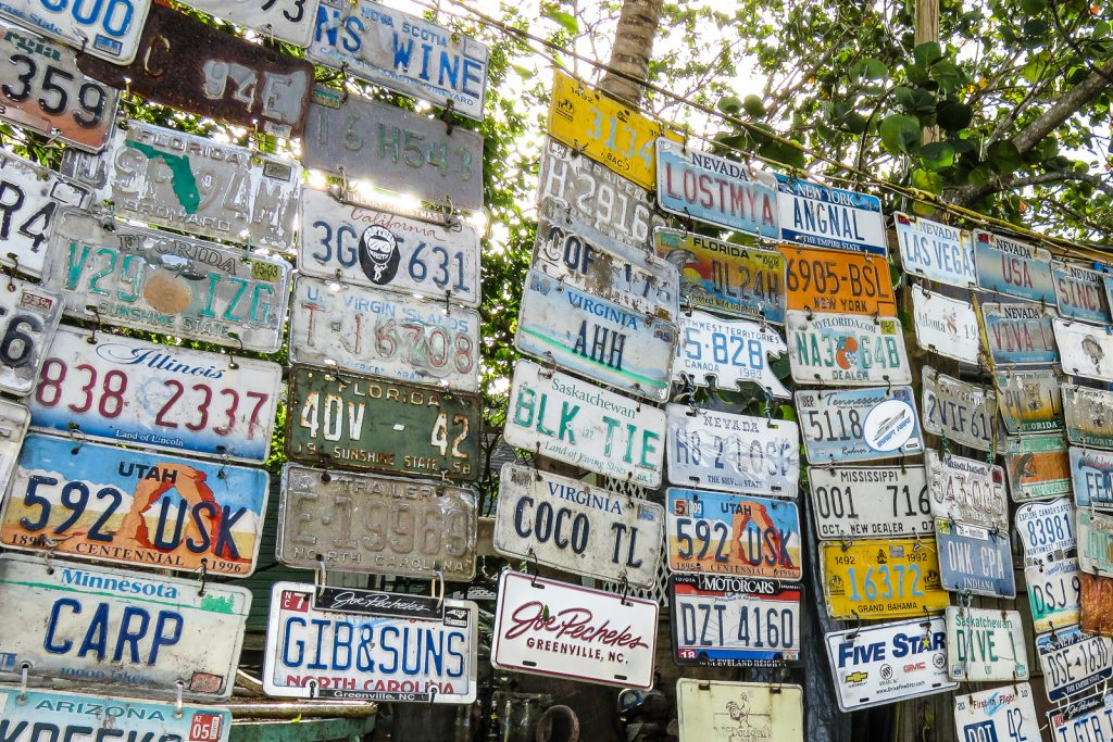 Numberplates from across the States hang next to a road in Dunmore Town, Harbour Island bahamas.