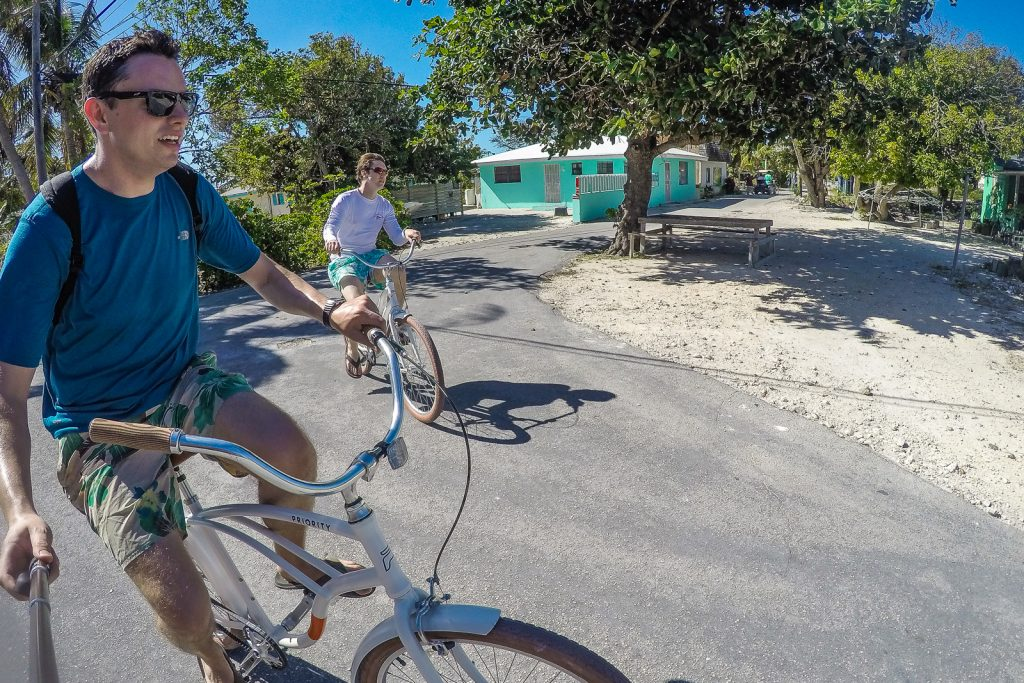 Exploring Staniel Cay on bikes. It's easy to cycle around as the Staniel Cay village is very small. Cycle to the docks, beach, airport, shops and the Staniel Cay Yacht Club.