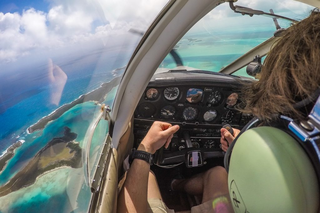 Flying along the Exumas from Staniel Cay (swimming pigs) to George Town and the Tropic of Cancer Beach. Exuma is the Out Islands Bahamas.