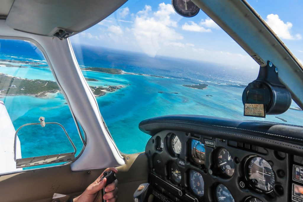 Flying into staniel cay for the exuma pigs, known as the swimming pigs. Staying at the Staniel Cay Yacht Club is one of a few exclusive Staniel Cay Hotels. Also at Staniel Cay is the Thunderball Grotto and bahamas iguanas.