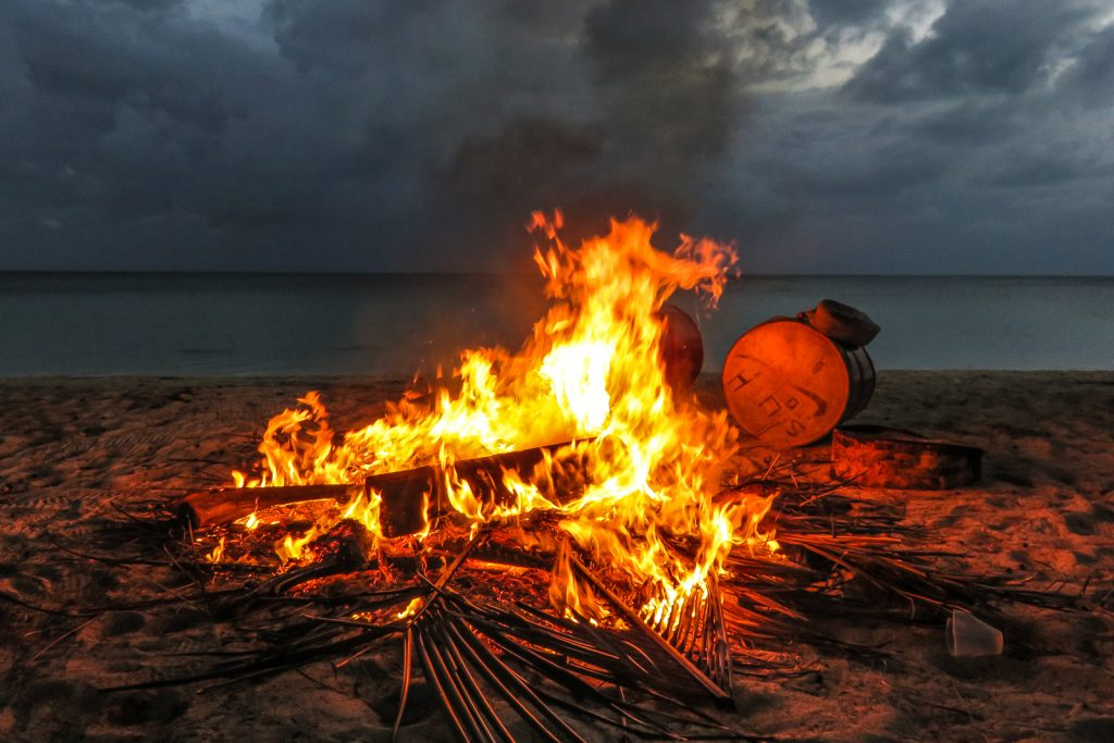 Cat Island Bahamas cultural village, in New Bight Cat Island, a fire is lit to heat up the drums for the Junkanoo music parade