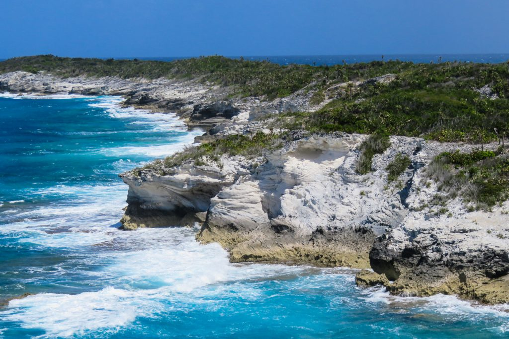 The cliffs guard the entrance to the Columbus Cove, one of the Landing sites of Christopher Columbus on Long Island, the Bahamas
