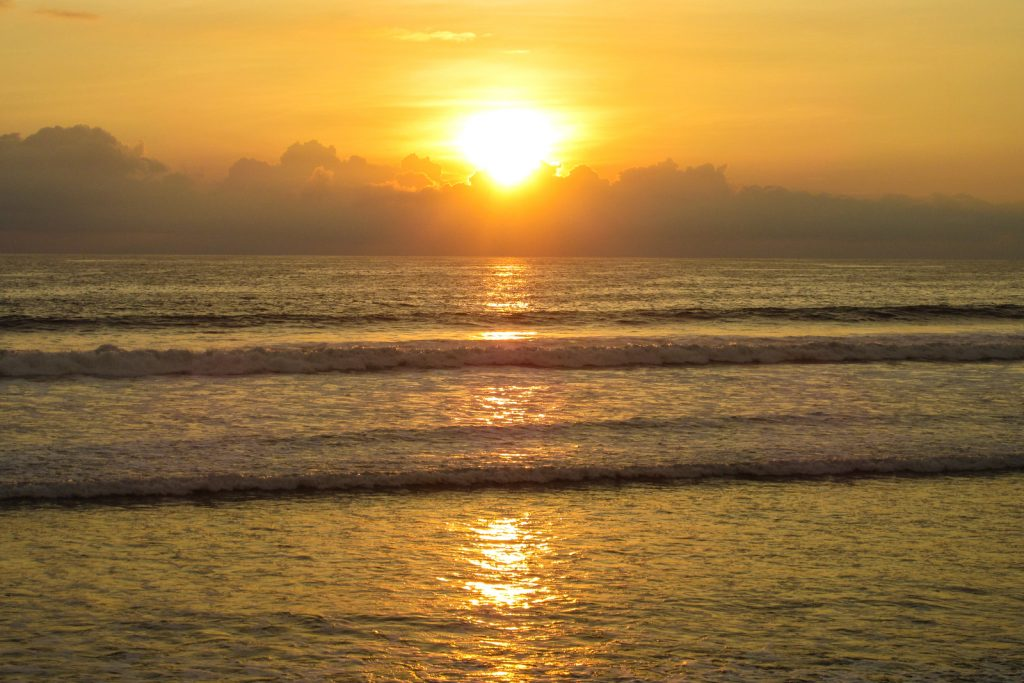 Things to do in Ecuador, Surfing in Montanita. As the Sunsets over a beach in Montanita Ecuador