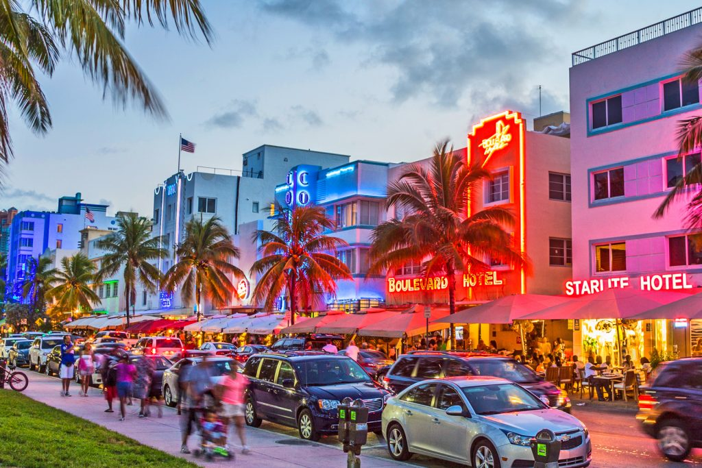 South Beach Ocean Drive Miami Florida People Enjoy Palm Trees And Art Deco Hotels