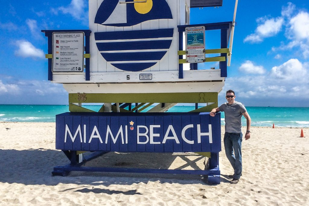 Things to do in Miami Beach, walk along South Beach on Miami Beach, colorful Lifeguard huts along miami beach florida. Visit Bayfront Park Miami.