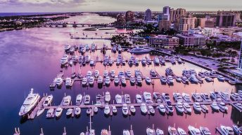 Things to do in West Palm Beach Florida. Palm Harbor Marina Aerial View at sunset with storm approaching. Sky reflecting off the water