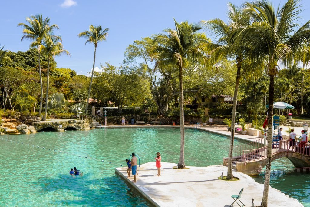 Things to do in Miami. Venetian Pool Coral Gables. People swim and relax around the public swimming pool known as the Venetian Pool in a residential area of Coral Gables. The pool was created in 1924 from an old coral rock quarry that was abandoned in 1921