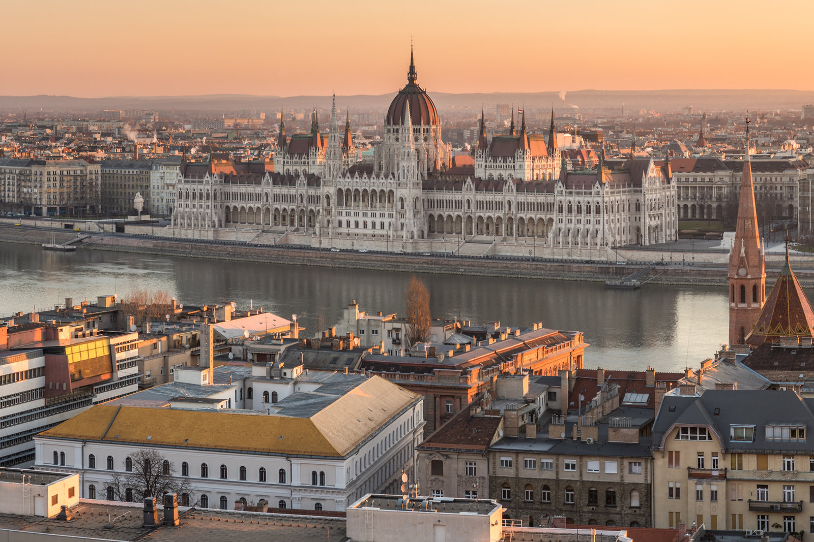 Discover what to do in Budapest. The best things to do in Budapest on trips to budpatest. From the chain bridge budapest to the budapest Christmas market. Wide Panorama of Budapest with Hungarian Parliament and Danube River at Sunrise