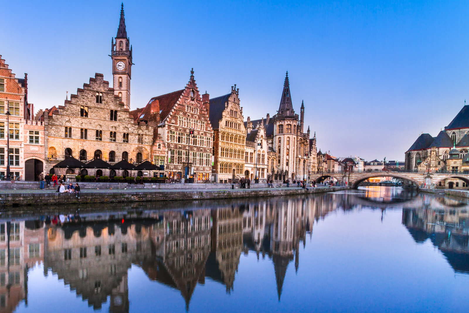 "Things to do in Belgium Ghent City. Discover the things to do in Ghent on a backpacking belgium tour. Picturesque medieval buildings overlooking the ""Graslei harbor"" on Leie river in Ghent town, Belgium, Europe."