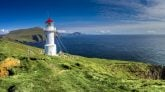Things to do in Denmark Faroe Islands Travel. Panoramic view of Old lighthouse on the beautiful island Mykines. Best time to visit Faroe Islands.