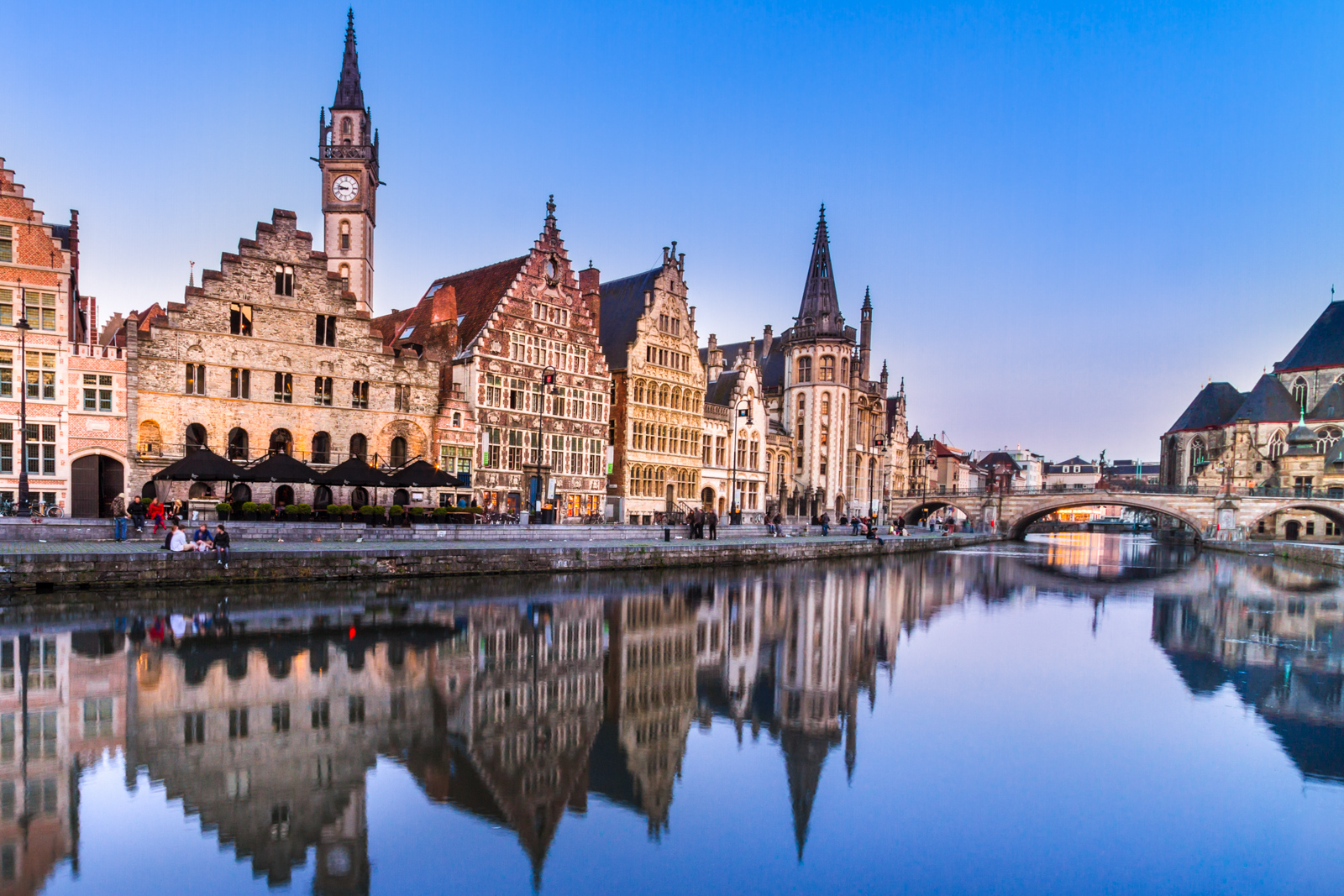 "Things to do in Ghent Belgium. Discover the things to do in Ghent on a backpacking belgium tour. Picturesque medieval buildings overlooking the ""Graslei harbor"" on Leie river in Ghent town, Belgium, Europe."