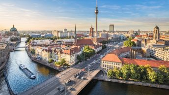 Top ten things to do in Berlin; from a free walking tour berlin to the berlin old town. Discover the top 10 berlin attractions. Aerial view of Berlin skyline with famous TV tower and Spree river in beautiful evening light at sunset, Germany
