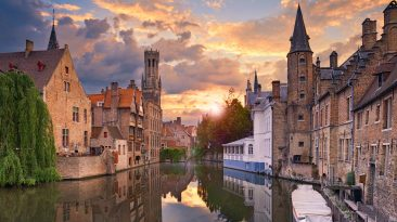 What to do in Bruges Belgium and the top things to do in bruges belgium and the historic center of brugge. Image of famous most photographed location in Bruges, Belgium during dramatic sunset.