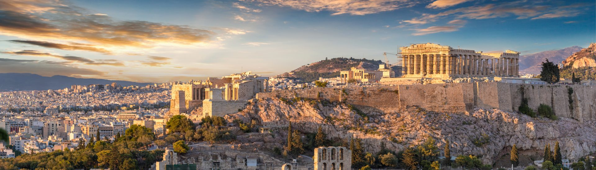 Things to do in Athens Greece: The Acropolis of Athens, Greece, with the Parthenon Temple during sunset. One of the top places to visit in Greece.