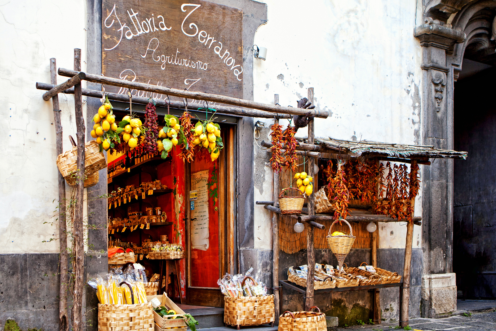 Top things to do in Amalfi Coast vacations in Sorrento, Italy - March 23, 2012. A farmhouse market on a street in Sorrento Italy with fresh pasta and produce for sale