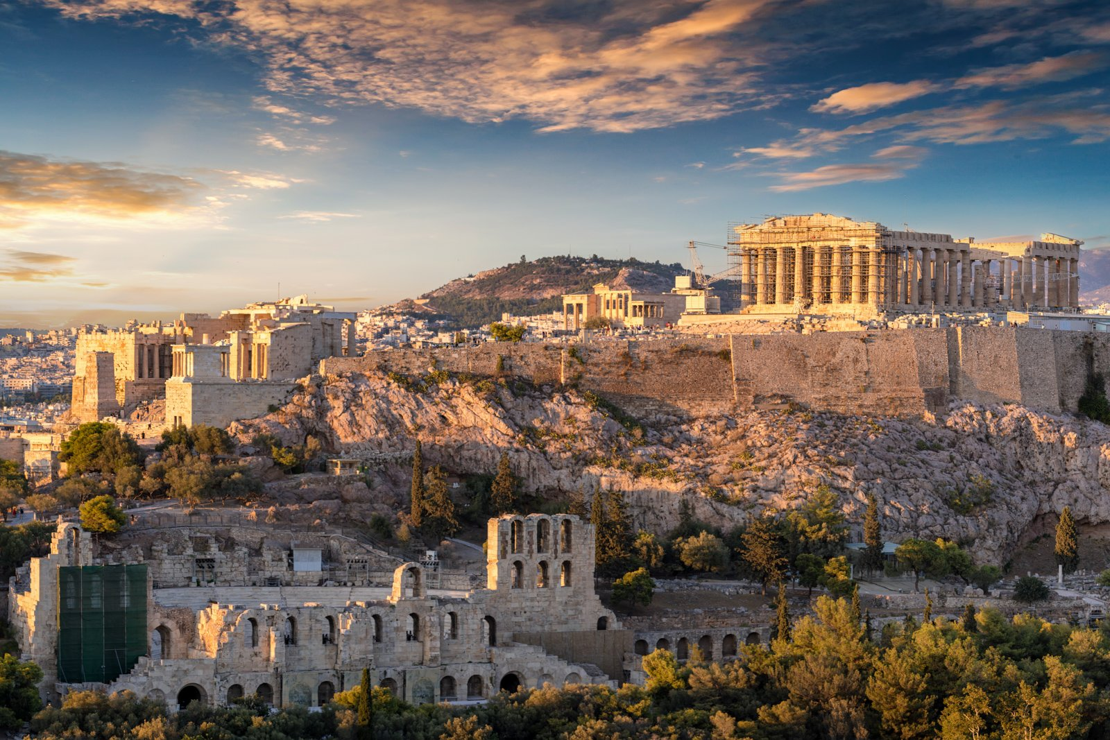 What to do in Athens Greece Acropolis and what to see in athens landmarks. The Acropolis of Athens, Greece, with the Parthenon Temple during sunset