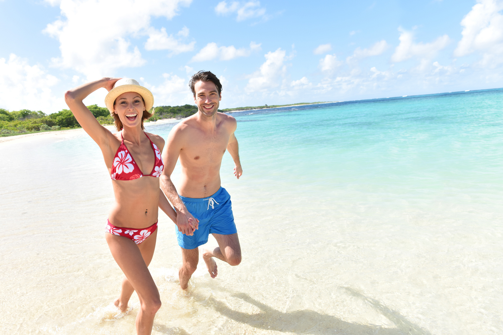 A Bahamas Day Trip can be one of the top Miami Attractions. Cheerful couple running on a white sandy beach. Your guide for all the top Miami attractions and best things to do in Miami. There are Plenty of tourist attractions in Miami Florida. This Guide presented by Flying and Travel.
