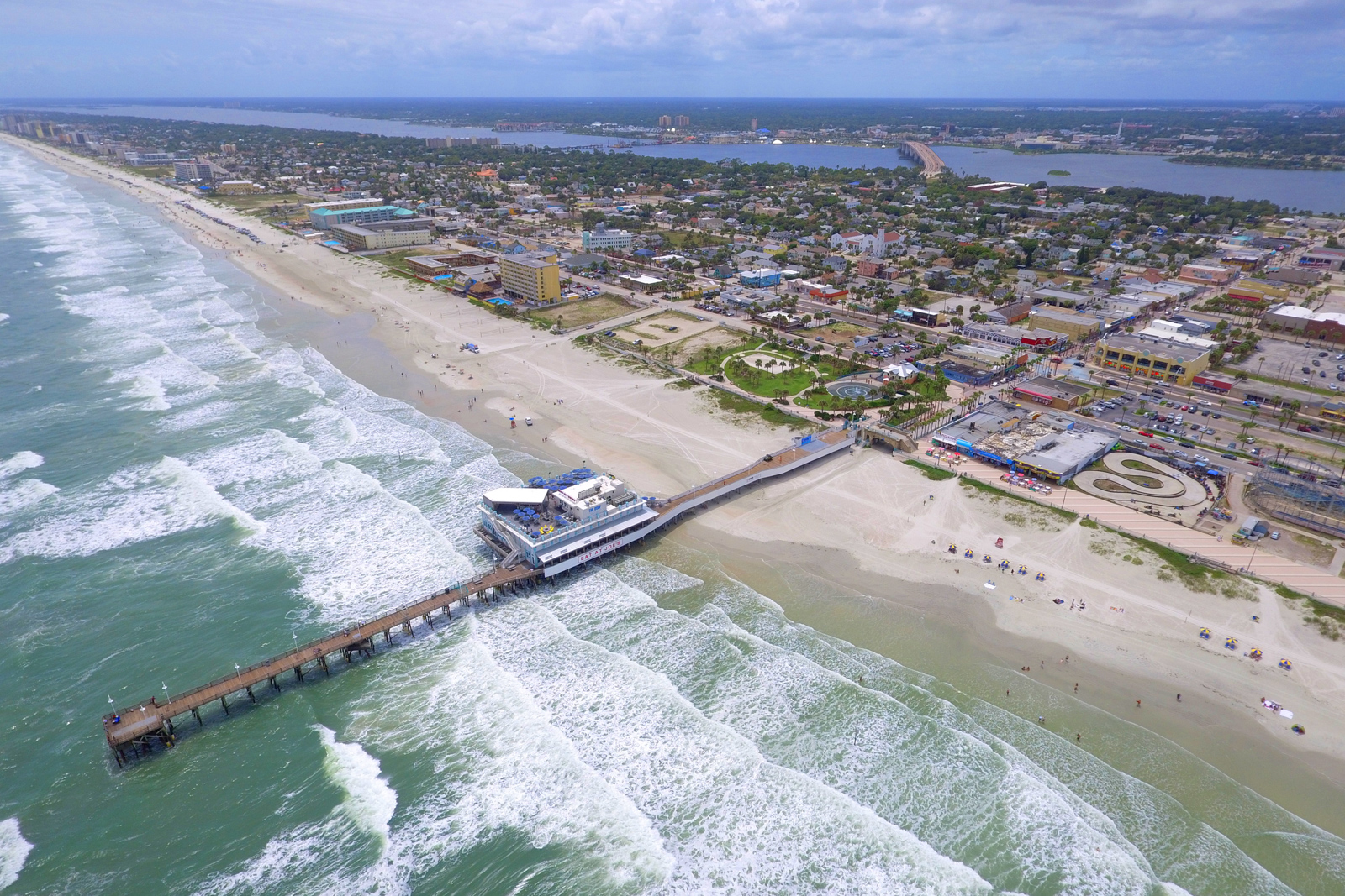 Aerial drone photo of Daytona Beach and fishing pier. One of the best Florida Beaches and best places to go in Florida. The beach has some of the best resorts in Florida on the best beaches in Florida. This photo a part of top 10 Beaches in Florida brought to you by Flying and Travel which presents all the nice beaches in Florida and best Florida vacation spots.