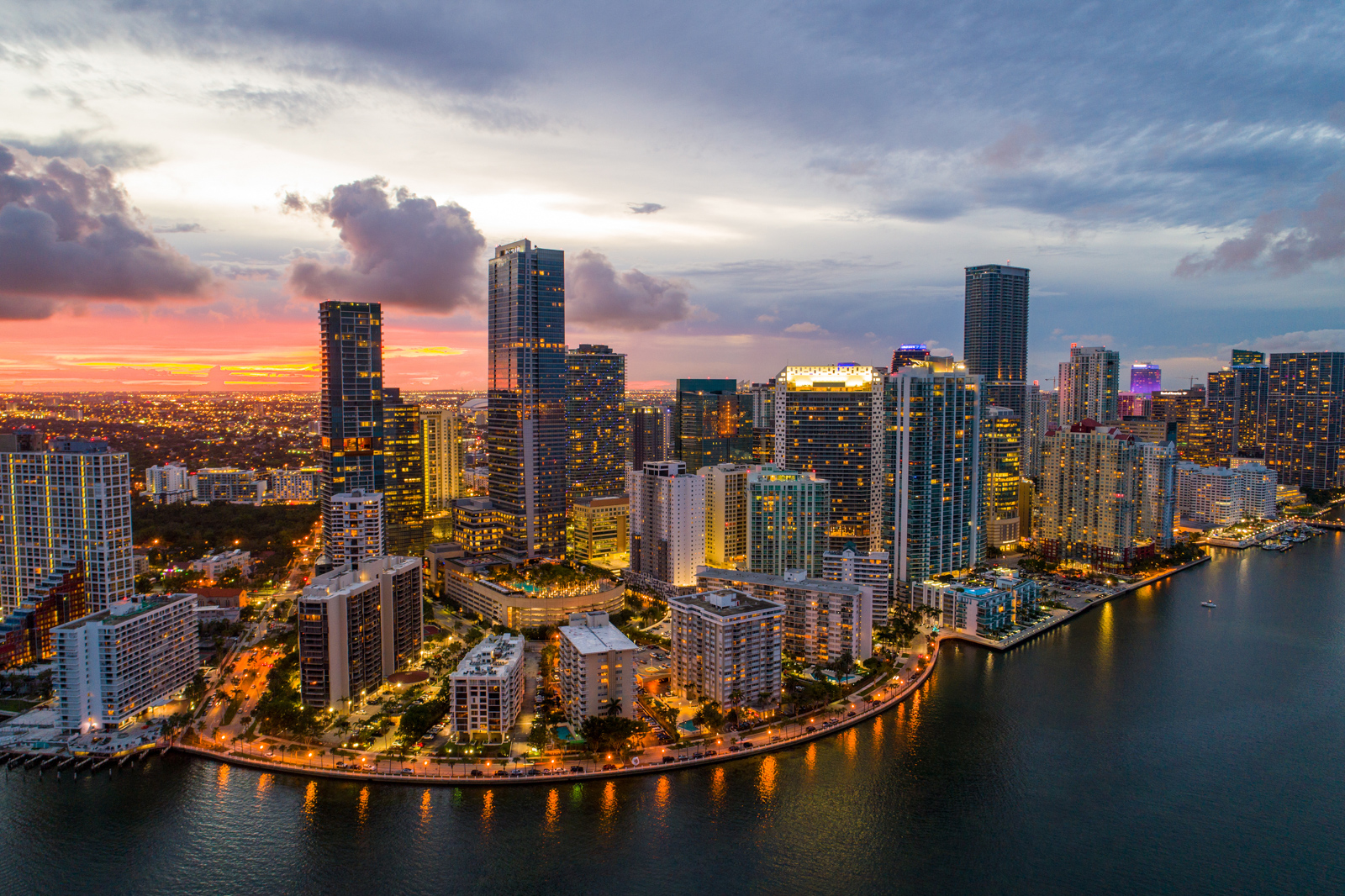 Aerial twilight in Brickell Downtown -- tourist attractions in Miami Florida. Your guide for all the top Miami attractions and best things to do in Miami. There are Plenty of tourist attractions in Miami Florida. This Guide presented by Flying and Travel.