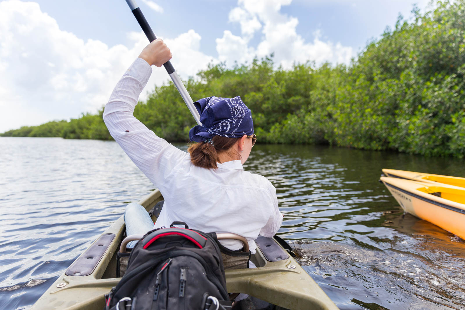 Tourist kayaking in mangrove forest in Everglades National Park. There are plenty of fun things to do in Florida and the Everglades is just one.
