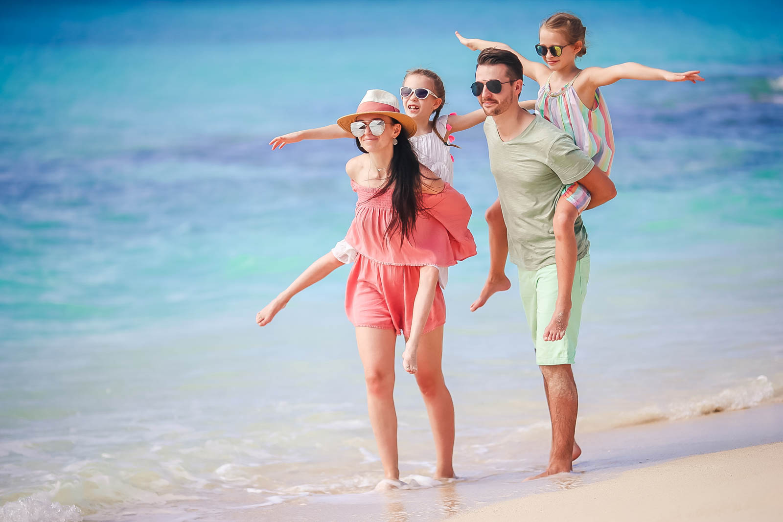 Young family on Bahamas vacation. Take a day cruise to Bahamas to experience the same fun on Bahamas day trip from Miami via Bahamas air charter.