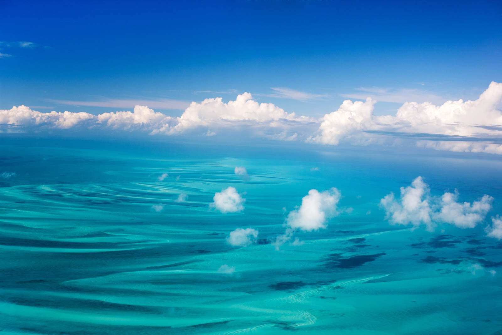 Beautiful view of Bahamas islands from above on a Bahamas air charter. The boat from Miami to Bahamas cannot offer these views on your Bahamas day trip.