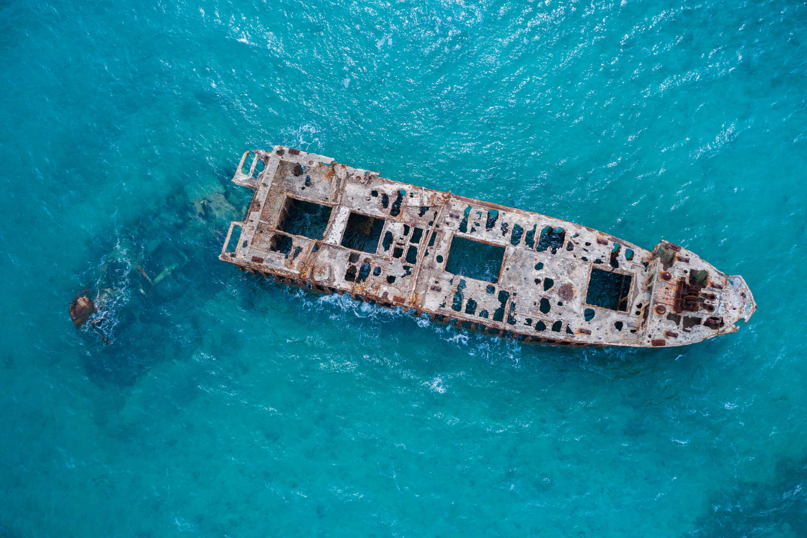 Sapona Shipwreck of the Bahamas in the Caribbean Sea. Any day cruise to Bahamas will show you beautiful blue waters and secluded beaches on Bahamas day trip from Florida to Bahamas.