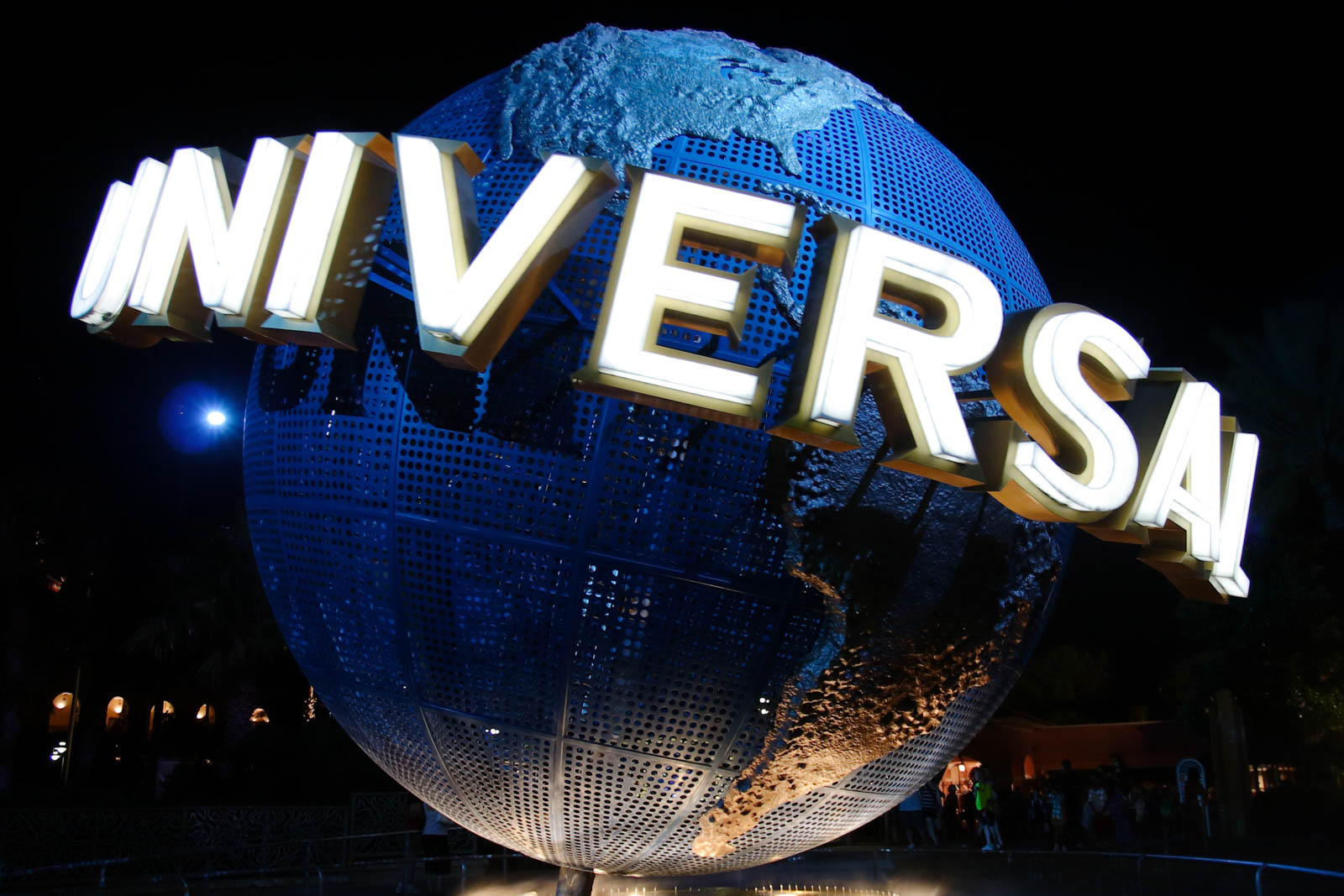 Universal studios sign at night in Orlando, Florida. There are plenty of things to do in Orlando that aren't theme parks, too. Some of the best things to do in Orlando are the many cool day trips.