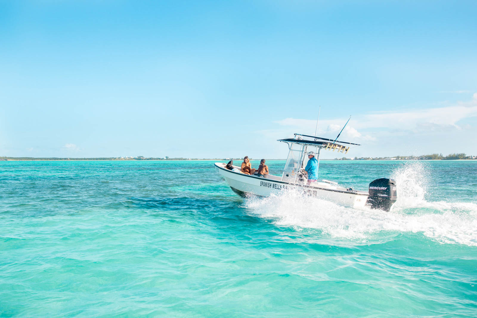 Take a boat out on the turquoise waters of the Exumas. Looking for what to do in the Bahamas? Read this guide for more things to do in the Bahamas.