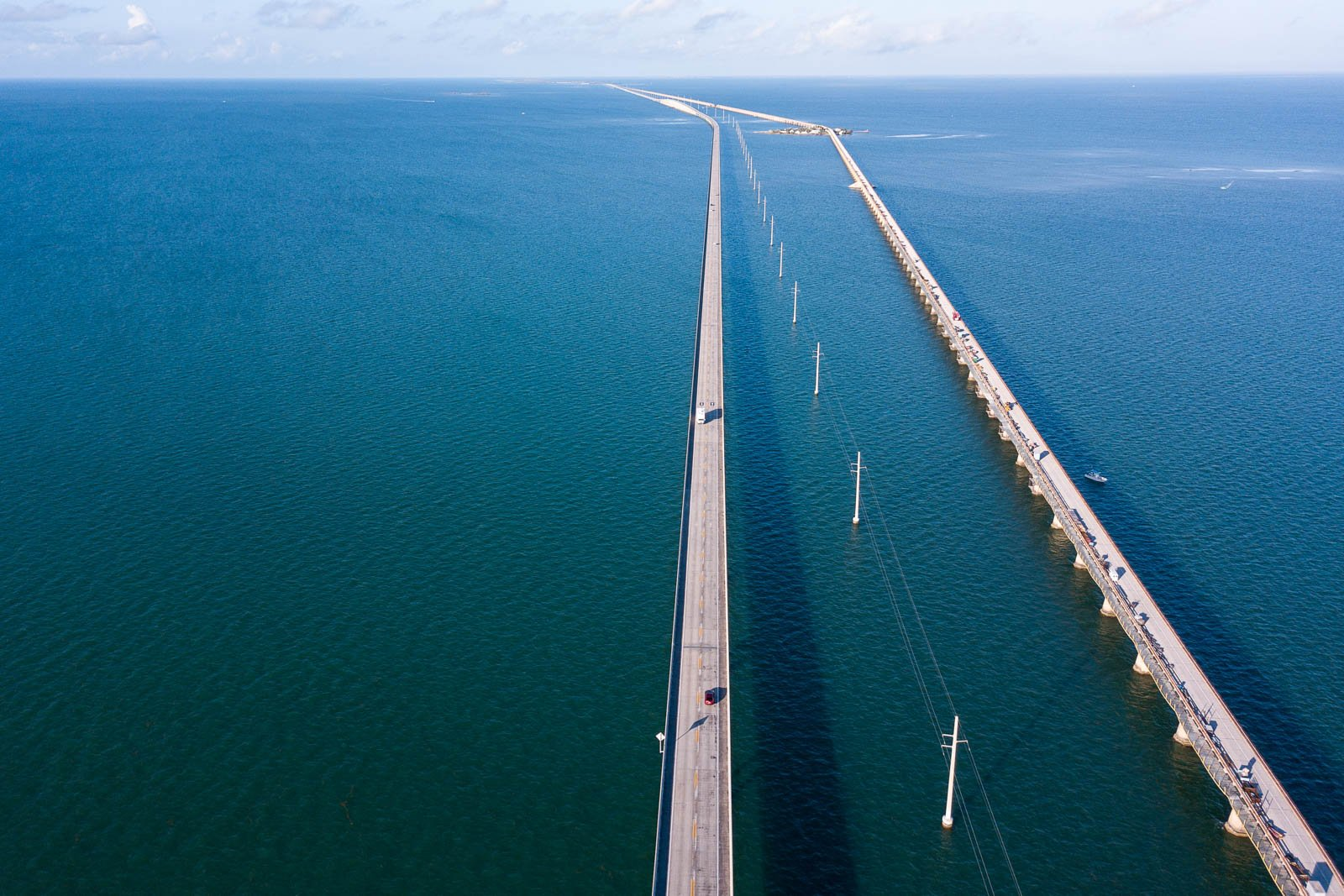 Take the Seven Mile Bridge above beautiful ocean water on your way to the Florida Keys. Wondering where to go in Florida? Not anymore, it is one of the most fun things to do in Florida.