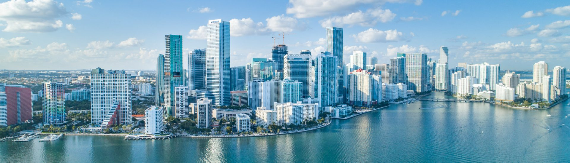An aerial shot of Brickell Key, with downtown cityscape. A flyover of Brickell Key is one of the best places to visit in Florida and among the many fun things to do in Florida.