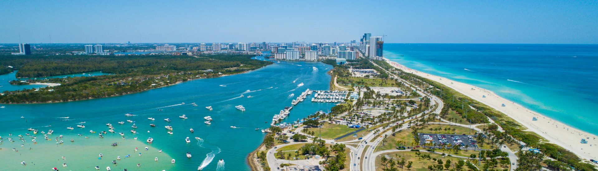 Aerial drone image of Miami Beach Haulover Park. The best day trips from Miami involve flying -- including day trips to Bahamas.
